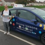 Smiles after passing driving test with driving lessons Liverpool